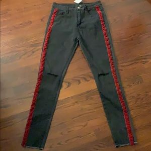 NWT black jeans with red stripe and knee rips